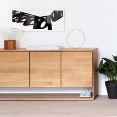 This Ethnicraft Oak Nordic 4 Doors Sideboard, crafted from solid European Oak, is defined by clean lines, showcasing a timeless and contemporary design. Also available in store other Ethnicraft Oak Nordic Range. Made by Ethnicraft, Belgium. Decor, Furniture, Oak Furniture, Home Furniture, Home Decor, Nordic Sideboard, Oak Cupboard, Ethnicraft Furniture, Wood Furniture