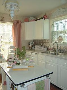 classic cottage kitchen - love the enamel top on the island. see remodel details on link.  Will remember to look for enamel table at garage, junk sales.