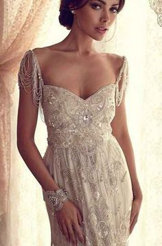The way the tiny strands of beads hang down like delicate shoulder chandeliers. | 50 Gorgeous Wedding Dress Details That Are Utterly To Die For Anna Campbell dress