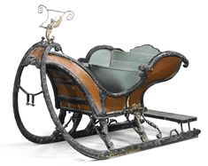 A Dutchiron-mountedgreen and brown painted and ebonised carved wooden sleigh 18th century  Sotheby's