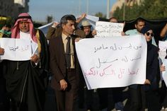 Palestinians hold placards as they attend a rally against the demolition of the Tel Es-Sakan hill, south of Gaza City.The writing in Arabic reads: ''Stop the crime''  Also Read: ► 11 years after creating 'League of