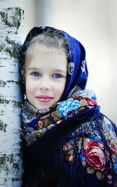 A beautiful Russian girl in the national shawl.