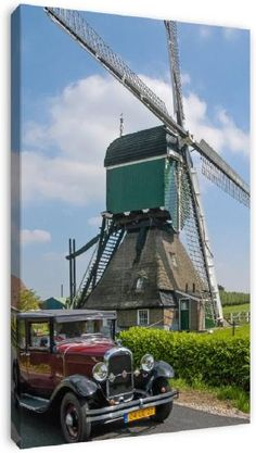 Windmill with classic car, near Bleskensgraaf, Netherlands