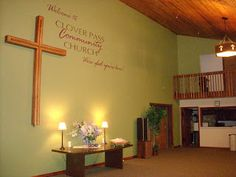Welcome center-cross on wall with church name and motto- making room for Jesus Christ in every story