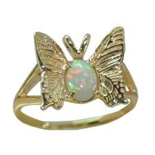 Adorable butterfly with a sparkling opal body in 14 karat yellow gold