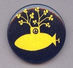 flowers grow out of a yellow submarine peace button from 1968