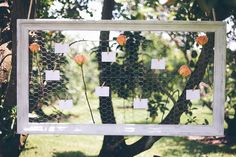 window frame and chicken wire made to clip wedding notes