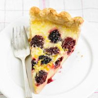 Lemon-Blackberry Pie --- If you like lemon bars, this pie is for you. I made it with my own crust recipe rather than the one called for, but other than that, did what it called for and it had a delicate sweetness and delightful tartness, all in a custard consistency. Fabulous.