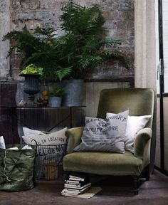 Love this sitting area - the chair, pillows, plants