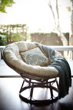 """Somehow just looking at an iconic Pier 1 Papasan Chair makes us feel more relaxed. This one's handcrafted of natural—and naturally durable—rattan, then finished with a rich, brown stain and high-gloss lacquer. All of which is just another way of saying, """"Ahhh."""""""