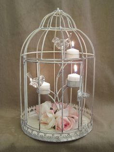 Distressed Shabby Bird Cage Candle Holder / Wedding Table Centerpiece / Glam / Pink / Shabby Chic Decor. $65.00, via Etsy.