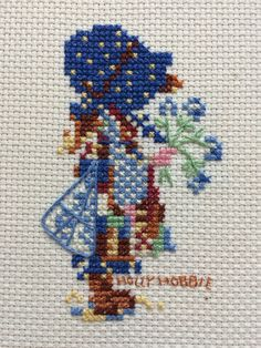 $12.99 2017 Handmade cross stitch of Holly Hobbies Classic Blue Girl. Framed in a 5x7 wooden frame and finished professionally with sealed brown paper and a sawtooth hanger.