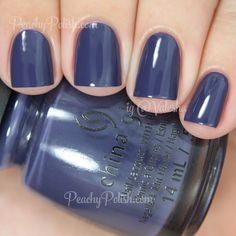 "China Glaze History Of The World | The Giver Collection | Peachy Polish ""History Of The World"" is a creme that looks like a dusted navy in the bottle but on the nail took on a slightly blurple look, though it still leans mostly blue.  Another dusty confection that I just love.  2 coats."
