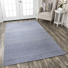 Simple and subdued, this rug features a subtle zigzag pattern in a soft blue hue. Crafted from 100% wool, the Ava Rug is handmade in the traditional, flat-woven dhurrie style, with a tight, durable weave that's ideal for high-traffic spaces.