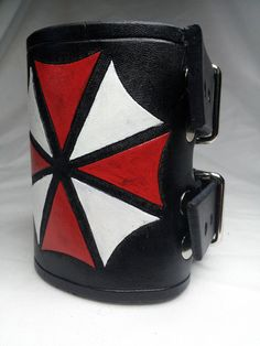 Resident Evil Umbrella Corporation Wrist Cuff / by deadlance, $50.00. If I was rich.