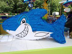 Love this piñata!!!   found here: http://www.flipflopsandpoptarts.com/2012/10/its-all-about-shark-birthday-partyfun.html