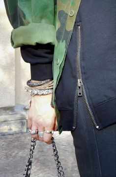SHADES OF K  by Karen  Wearing camouflage jacket, black leather pants, black oversized hoodie, studded red leather boots, black oversized sunglasses, and stacked bracelets. Autumn style, Street Style, Isabel Marant vibes