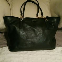 Coach Tote Soft leather tote with zipper closure. The handle is part chains and leather.  Never used,mint condition    The hardware is gold tone and scarce free Coach Bags Totes
