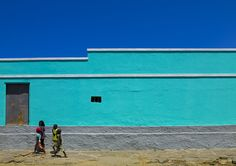 Namibe town buildings - Angola  Namib is a town in Angola, on the sea. Many old buildings, cool atmosphere. An indigestion of squids..   © Eric Lafforgue