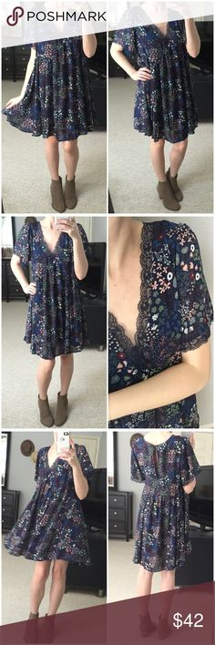 """Navy Floral Boho Babydoll Swing Dress Navy floral pattern Babydoll swing dress! Love how flirty and feminine this one is- perfect boho dress for spring! Lace accents on v-neck and sleeves. Button closure on back. Double lined-inner lining is stretchy and comfy! Very nicely made and has a oversized & loose fit. Would work with a bralette peeking out in front. Just so cute! Modeling small. 60% cotton 40% polyester. Measurements as follows: Bust: (S) 19"""" (M) 20"""" (L) 21"""" Length: (S) 35"""" (M) 35""""…"""