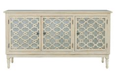 Tangier Buffet - This masterfully crafted buffet features Moroccan-inspired fretwork over brushed metal and a light finish of gray and natural tones. The three doors open to reveal space for storing serveware, table linens, and more.