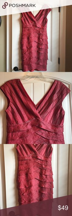 Adrienna Papell Dress Stunning Adrienna Papell cap sleeve, pleat e dress! The color is a red metallic. Great condition! The dress is lined and zips in the back. Adrianna Papell Dresses