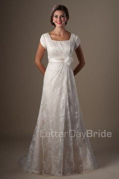 Brekenridge | This charming wedding gown features a unique design, with the overlay gathering to the satin waistband and flower accent along with a slightly mermaid silhouette. The creamy color highlights the ivory lace overlay to perfection.    Gown available in Deco Gold/Ivory, Ivory/Ivory or White.    *Gown pictured in Deco Gold/Ivory.     Available at LatterDayBride.com or in Store at Gateway Bride | Home of the LatterDayBride Collection in SLC, UT