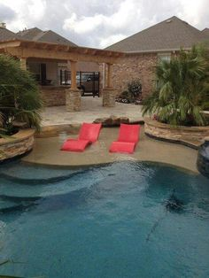 Cool beach backyard with cooking and lounge area. Stone rimmed pool. And to really have a blast in your backyard, check out Tiki Toss. Playtikitoss.com
