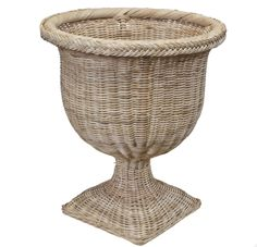 """Made from sustainably harvested natural materials.This product is all natural and is recommended for indoor or covered porch use only. """"The difference between rattan and wicker is that rattan is the material used, while wicker is the woven technique employed to make the furniture."""" Belle Vivir Size Pedestal: 13.5""""Sq x 43""""H Size Urn: 17.5 D x 21.5""""H This item will be ready to ship in mid-October. Pedestal Stand, Pedestal Dining Table, Wicker Planter, Vintage Planters, Best Sellers, Rattan, Braids, Traditional, Antiques"""