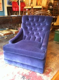 This pair of 1967 buttoned back club chairs with sloping arms have been reupholstered in a deep blue silk velvet. You'd likely propose to anyone with this pair of royal chairs in their home.
