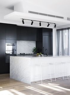 Best Interior Design Ideas : Mixing of Modern and Minimalist Style cool modern kitchen decor idea // track lighting for the ktichen // black stainless appliances // black cabinets // marble wrapped island // minimal modern white stools Black Kitchens, Interior, Kitchen Decor Modern, Best Interior Design, House Interior, Black White Kitchen, Modern Kitchen Design, Black Interior Design, White Kitchen Design