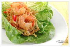 Spicy Shrimp Lettuce Wraps: Lettuce wraps filled with shrimp and cabbage and tossed with a spicy-sweet sauce make a light meal, great for lunch or at late dinner.
