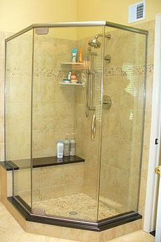 GAP 1669 N – Brushed Nickel Custom Neo Angle Shower This gorgeous enclosure with an upgraded bow handle has custom angles (not standard 135° neo angles) and a notched return panel to accommodate the bench seat. From the marble to the tile to the glass, this is one elegant shower!