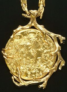 An 18ct. yellow gold pendant/necklace, by Salvador Dali.