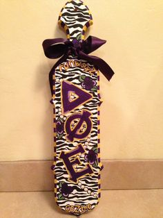 Delta phi epsilon paddle with purple and zebra designs. Love this paddle so much. Get creative when decorating your paddle. #DPhiE