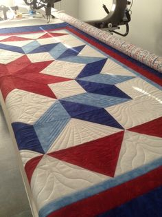 Quilt of Valor by the East Lauderdale Quilt Guild. Red, white and blue Carpenter's Star. Quilted by Singing River Quilt Co. There are six different block designs plus two border designs incorporated into the quilting. #patriotic #quilt