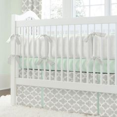 Crib Bumper in French Gray and Mint Quatrefoil by Carousel Designs.