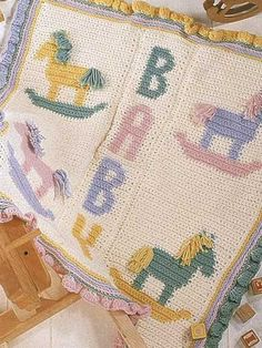 """Rock-a-Bye Baby I Playful rocking-horse afghan is stitched with medium (worsted) weight yarn and size G hook. 33"""" x 36"""". Skill Level: Intermediate Designed by Diana Maschino free pdf"""