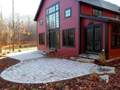 A Barn Home in the Upper Regions of Lake Michigan: Part 2 Red metal siding gray trim barn exterior Post & Beam Barn Home by Yankee Barn Homes. Metal Barn Homes, Metal Building Homes, Pole Barn Homes, Building A House, Pole Barns, Building Design, Yankee Barn Homes, Red Houses, Barn Houses