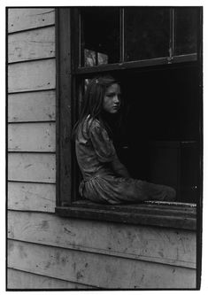 Girl sitting on windowsill. Kentucky, 1964. William Gedney