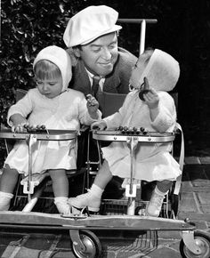 James Stewart takes his twin daughters, Judy and Kelly, for a stroll- 1952