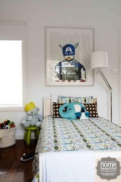 The playful bedspread is from Dwell Studio and the superhero artwork is by Jane Fontane, from United Galleries.