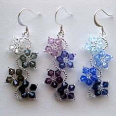 @Overstock.com - Sterling Silver Colorful Crystal Flower Earrings (USA) - Every woman can feel beautiful wearing these crystal flower earrings. These homemade earrings feature sterling silver round hooks, together with Swarovski crystals and seed beads in a variety of hues. They are sure to bring a smile to every woman. http://www.overstock.com/Main-Street-Revolution/Sterling-Silver-Colorful-Crystal-Flower-Earrings-USA/5303495/product.html?CID=214117 $19.99