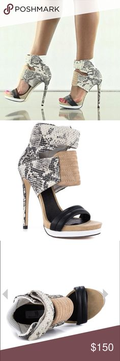 Rocco Sandals Lean with it Rocco with it! This eye catching style will have them all envious. Mia Limited Edition features a leather upper complete with a grey snake textured overlay. A pillowy back, velcro strap and 5 1/4 inch stiletto heel completes this trendsetting sandal. Mia  Shoes Heels