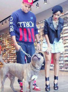 Chris going on a walk with his boxer dog Diamond and girlfriend Rihanna.