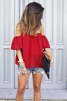 Cool and chic off the shoulder top is sure to be a hit dressed up or down. We love the bohemian inspired free spirit of this look. In red or black