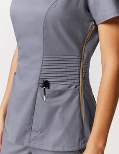 Pintuck Top in Graphite is a contemporary addition to women's medical scrub outfits. Shop Jaanuu for scrubs, lab coats and other medical apparel. Scrubs Outfit, Scrubs Uniform, Stylish Scrubs, Beauty Uniforms, Cute Scrubs, Medical Uniforms, Fancy Blouse Designs, Uniform Design, Medical Scrubs
