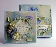 handmade cards by Dorota ... shabby chic ... lovely wreaths of delicate die cuts ... pale blues and greens ... posey of artificial flowers ... square format ... definitely for display ... gorgeous!!