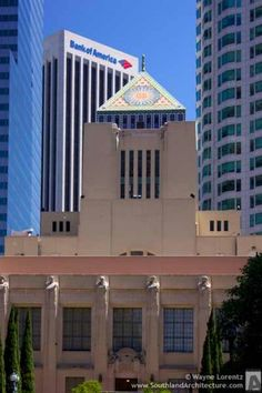 "Los Angeles Central Library:  Topping the building is a pyramid with suns on each side. At the apex is a hand holding the torch of knowledge. Surrounding the library are an odd series of terra cotta reliefs by Lee Oskar Lawrie titled ""Meaning and Purpose of Library"" depicting all sorts of things topics that might be researched inside from philosophy and history to religion and art."