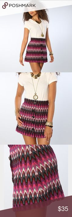 Free People Retro Button up mini skirt NWOT Never Worn Absolutely gorgeous chevron knit button-front mini skirt from Free People in purple combo! Purple, pink, teal, and white. Bought new, cut tags, decided it was too small, now have to M instead! This skirt is so fun in the summer or worn tights in the fall/winter! Any questions and offers welcome! 😆 Free People Skirts Mini